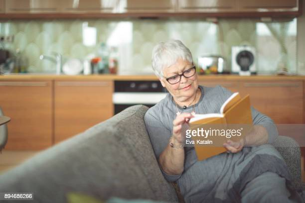 senior woman at home - reading glasses stock pictures, royalty-free photos & images