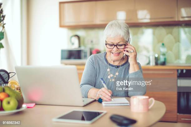 senior woman at home - 70 79 years stock pictures, royalty-free photos & images