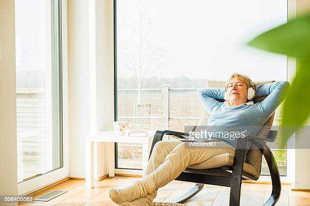 Senior woman at home relaxing with headphones