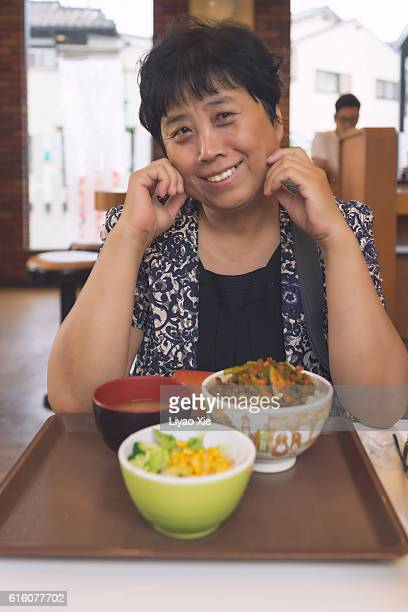 senior woman at lunch - liyao xie stock pictures, royalty-free photos & images