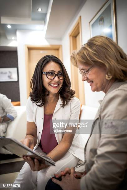 senior woman at the doctor - vertical stock pictures, royalty-free photos & images