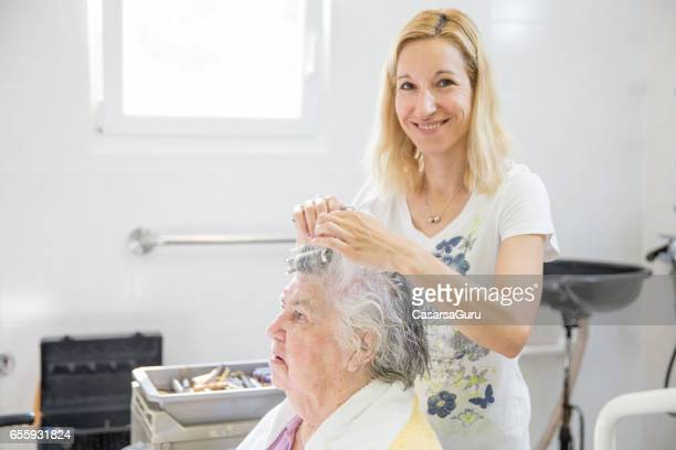 Senior Woman At The Hairdresses In The Retirement Home