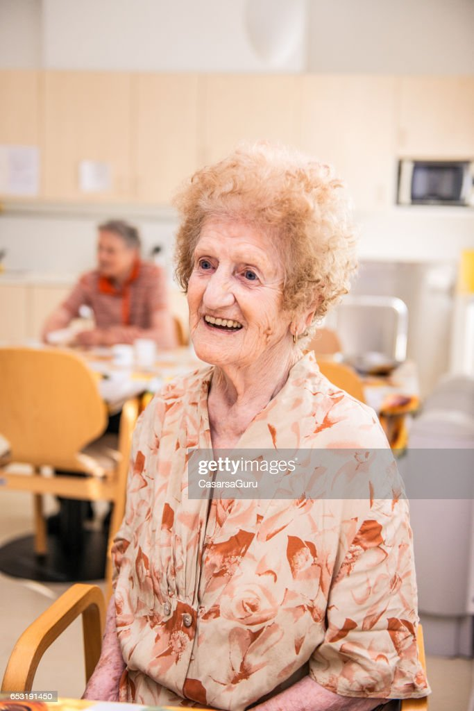 Senior Woman At The Nursing Home Sitting In The Dining Room : Stock Photo