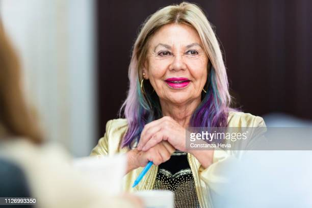 senior woman at work - south america stock pictures, royalty-free photos & images