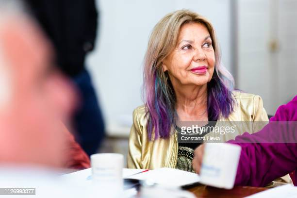 senior woman at work - purple hair stock pictures, royalty-free photos & images