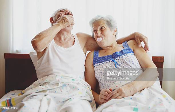 Senior woman blowing a gum
