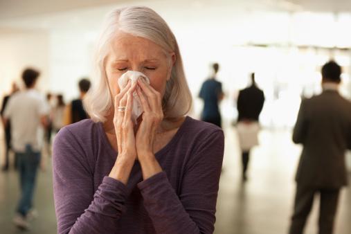 Senior woman blowing nose - gettyimageskorea