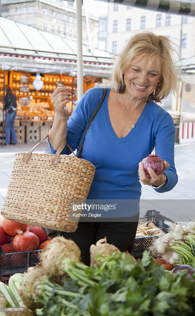 senior woman buying vegetables at the market : Stock Photo