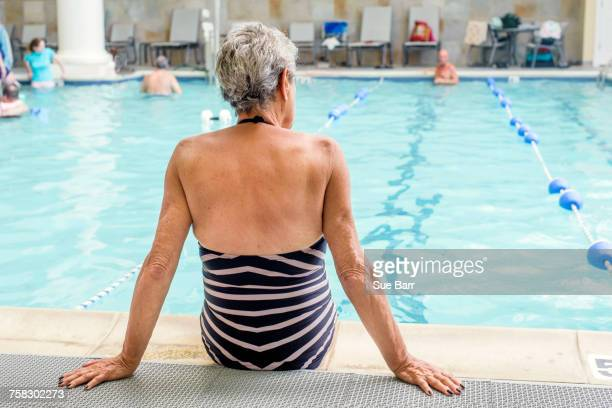 senior woman by poolside - length stock pictures, royalty-free photos & images