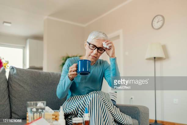 senior woman caught cold - infectious disease stock pictures, royalty-free photos & images