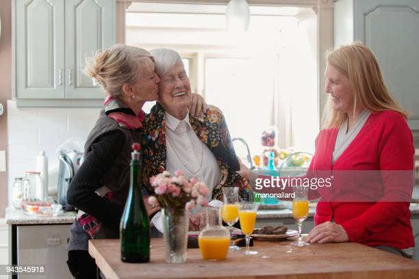 senior woman celebrate mother's day with her family - sibling stock pictures, royalty-free photos & images