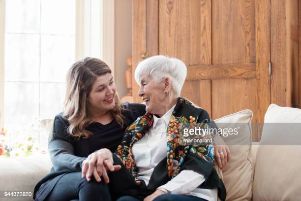 senior woman celebrate mother's day with her family - mother's day stock pictures, royalty-free photos & images
