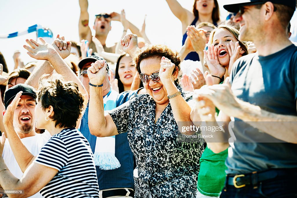 Senior woman celebrating during soccer match : Stock Photo