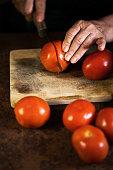 senior woman chopping tomatoes