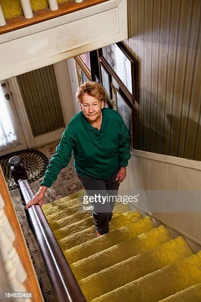 Senior woman climbing stairs