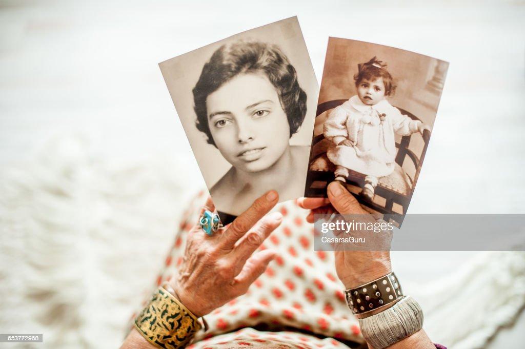 Senior Woman Close Up Hands Holding Memories : Stock Photo