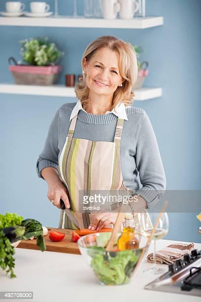 Senior woman cooking.