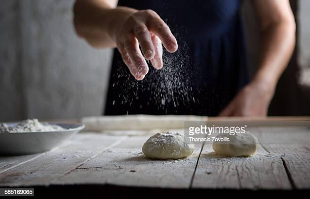 senior woman cooking - mehl stock-fotos und bilder
