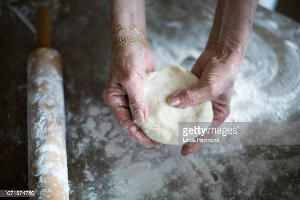 senior woman cooking pie - savory pie stock photos and pictures