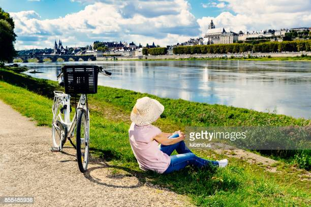 Senior woman cycling Loire Valley, France
