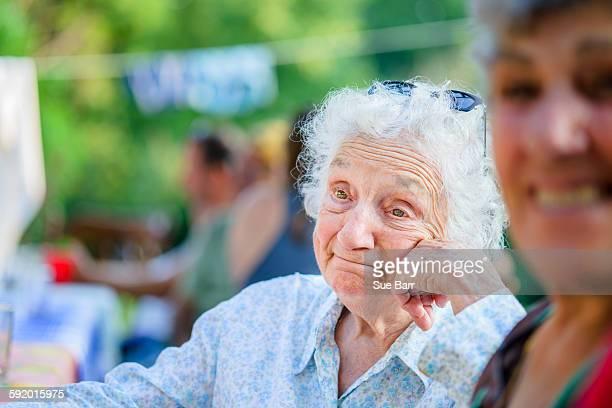 Senior woman daydreaming at tomato eating festival