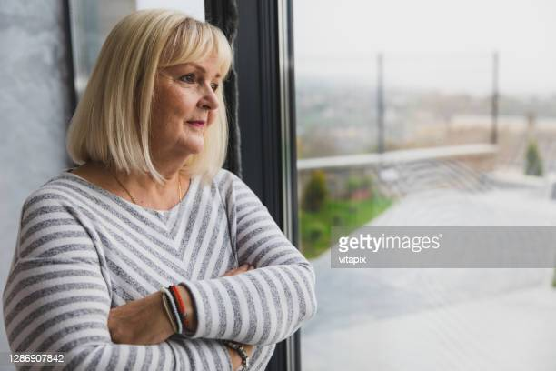 senior woman deep in thought - fat blonde women stock pictures, royalty-free photos & images