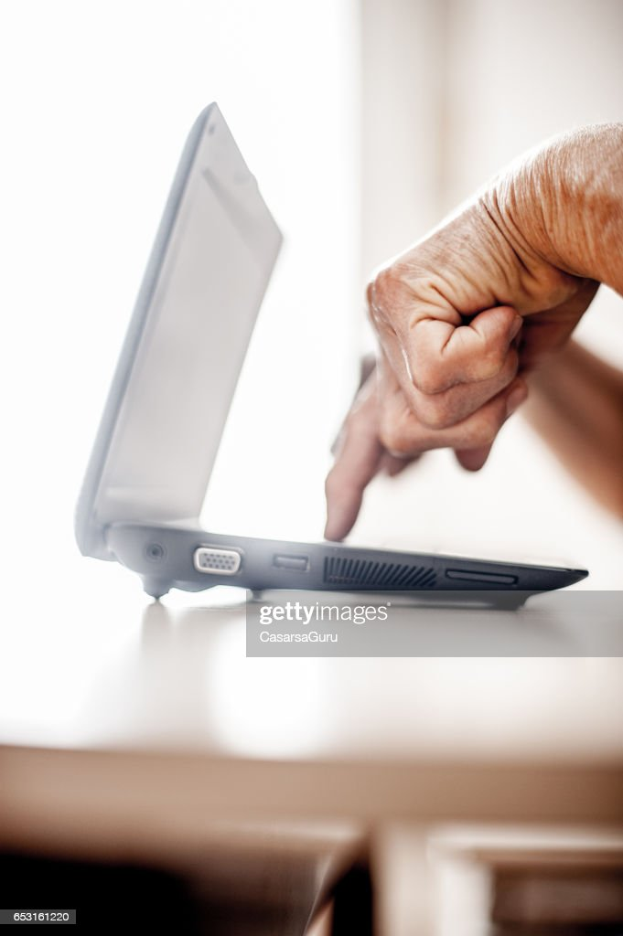 Senior Woman Determined To Use Computer - Close Up Hands : Stock Photo