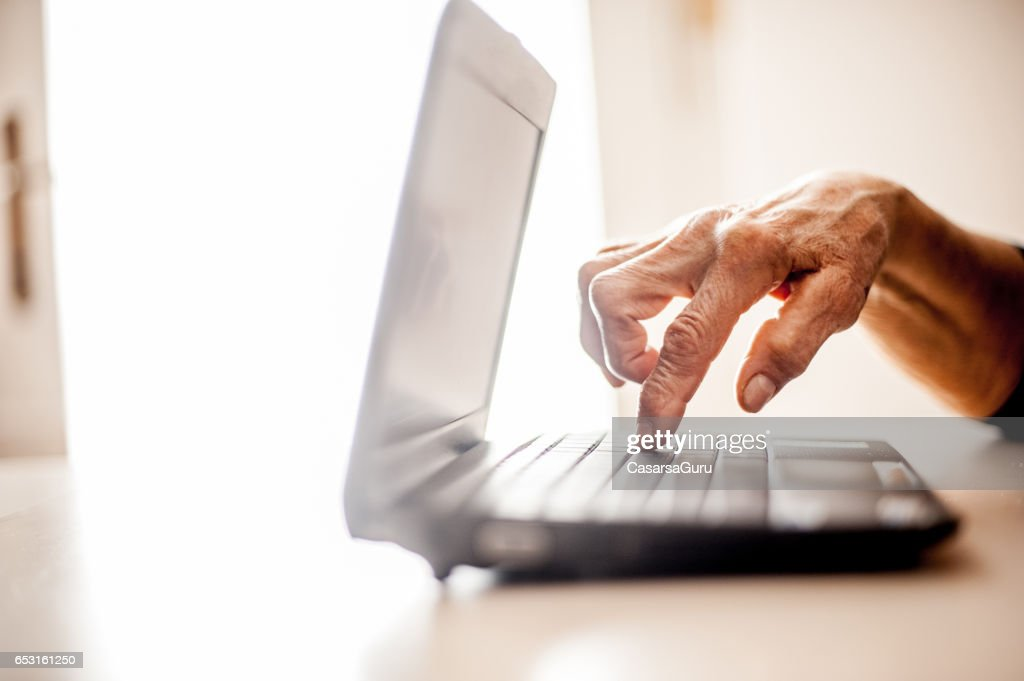 Senior Woman Determined To Use Computer - Close Up Hands : Foto stock