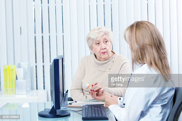 Senior Woman Discussing Prescription with Physician at Clinic Hz