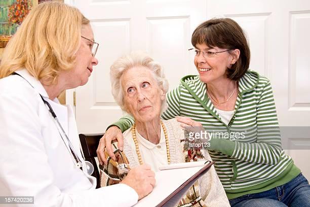 Senior woman, doctor, family.  Medical consulation. Healthcare. Nursing home.