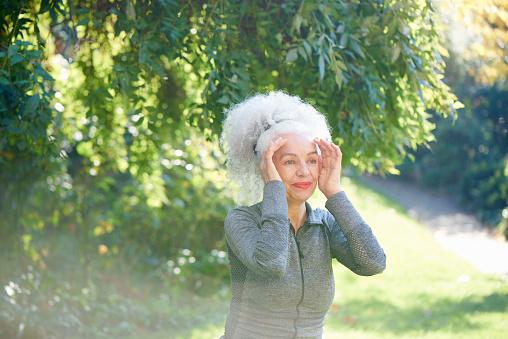 senior woman doing exercise in park - gettyimageskorea