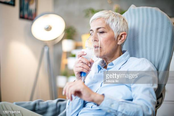 senior woman doing inhalation. - oxygen stock pictures, royalty-free photos & images