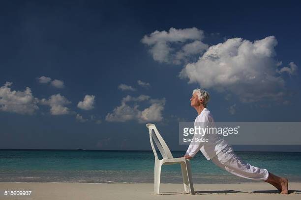 Senior woman doing work out on beach