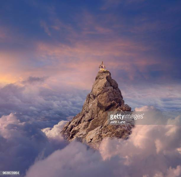 senior woman doing yoga meditation on a mountain peak - john lund stock pictures, royalty-free photos & images