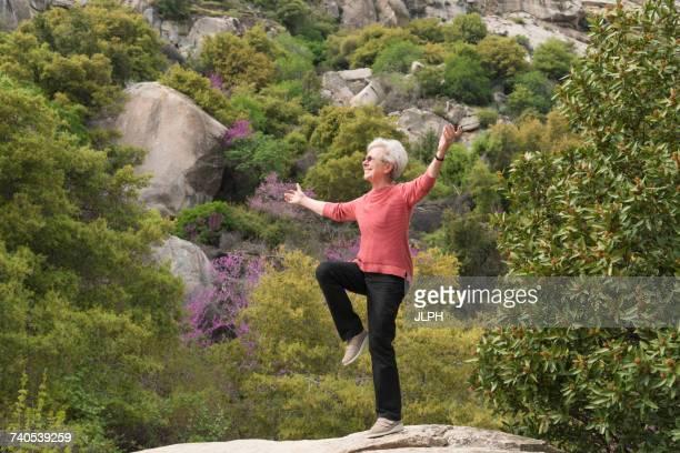 Senior woman doing yoga, Sequoia National Park, California, US