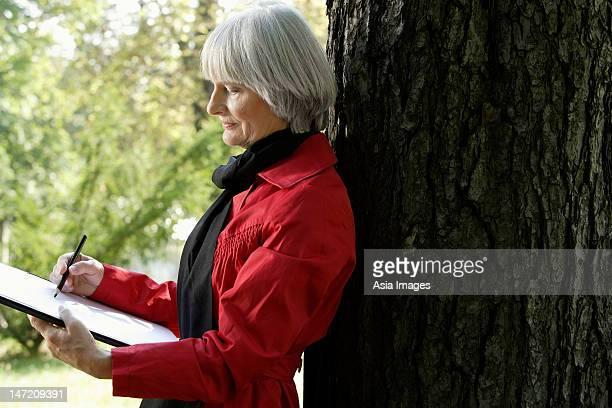 Senior woman drawing on sketch pad