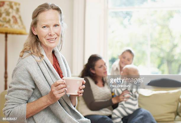 senior woman drinking coffee - british granny stock photos and pictures