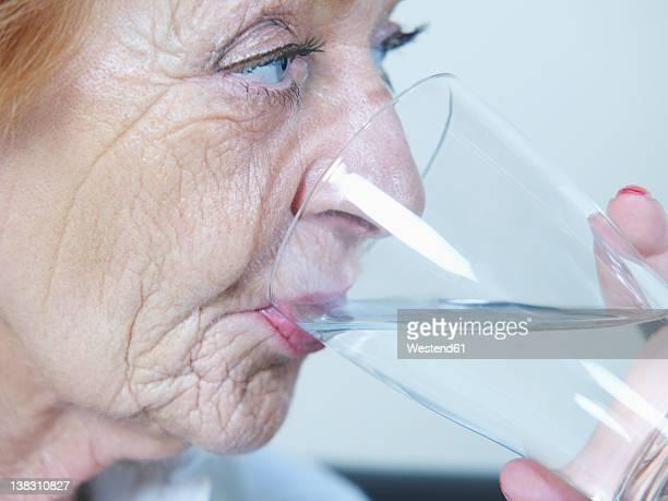 Senior woman drinking water, close up