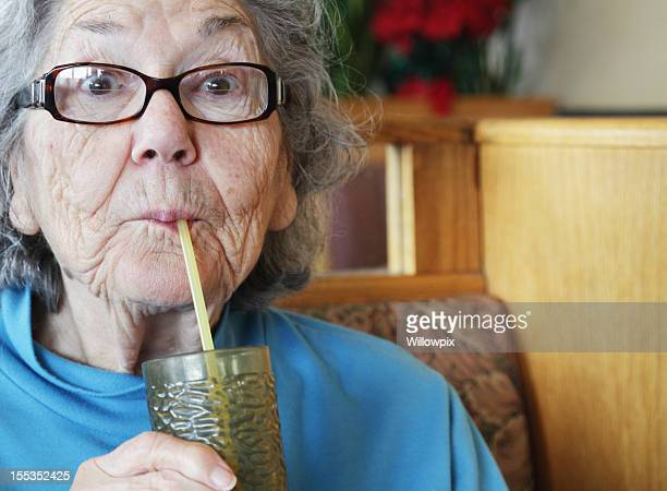Senior Woman Drinking Water With Straw