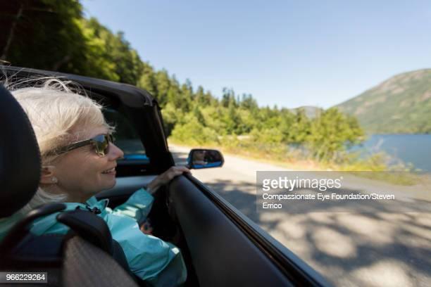 Senior woman driving in convertible