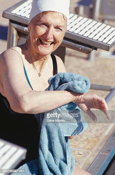 senior woman drying herself with towel after swim - drying stock pictures, royalty-free photos & images