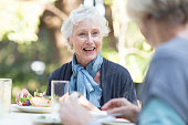 Senior woman eating lunch