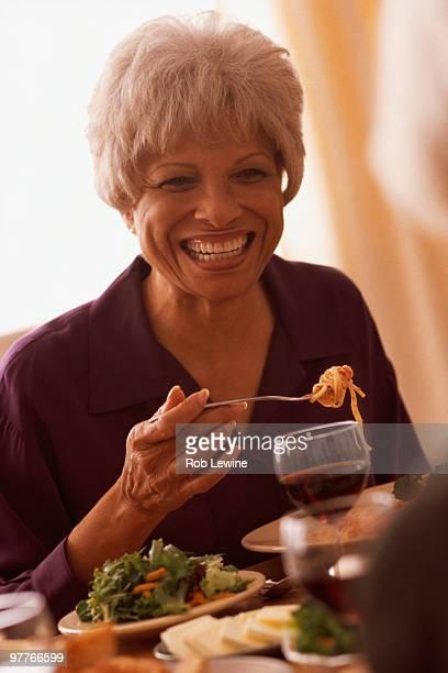 Senior woman eating meal