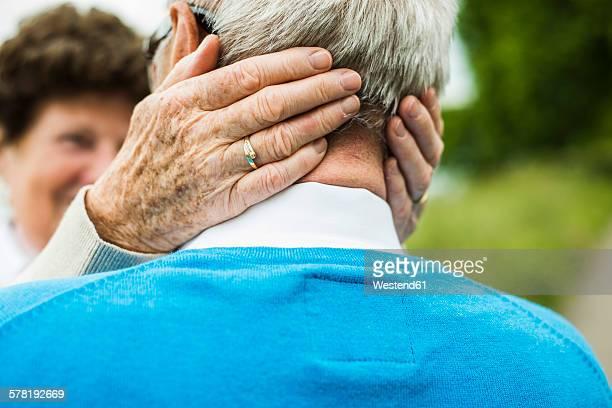 Senior woman embracing her husband, close-up