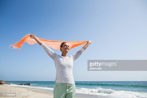 Senior woman enjoying a day on the beach