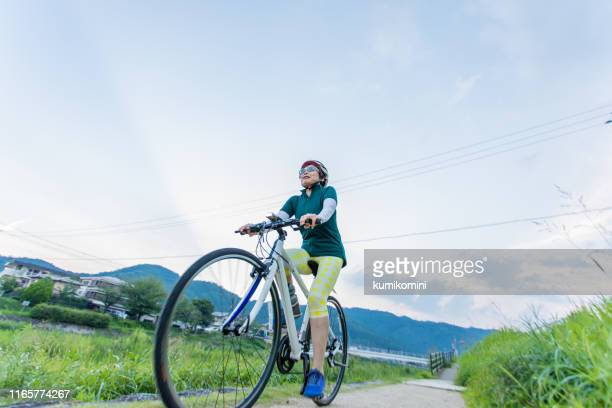 senior woman enjoying cycling - one senior woman only stock pictures, royalty-free photos & images