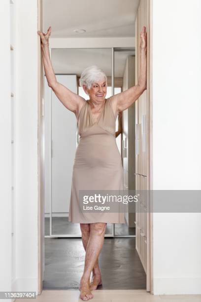 senior woman enjoying every moment of her life - disruptaging stock photos and pictures