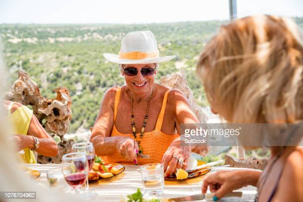 senior woman enjoying her meal - republic of cyprus stock pictures, royalty-free photos & images