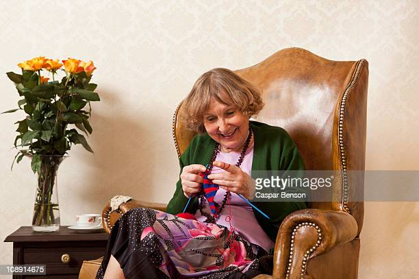 A senior woman enjoying knitting