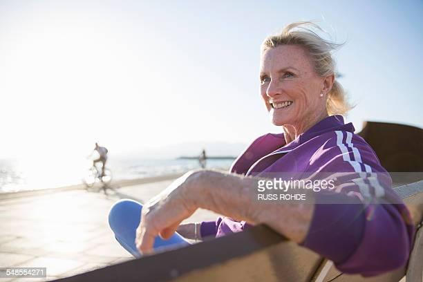 Senior woman enjoying ocean view on bench